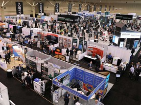 Visitors crowd booths at at the Prospectors and Developers Association of Canada (PDAC) annual conference in Toronto on March 1, 2020.