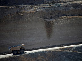A mining truck takes ore from the open-mine pit at a rare earths mine in California.