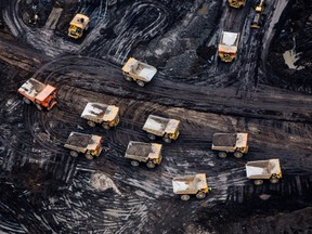 eavy haulers are seen at the Suncor Energy Inc. Fort Hills mine in this aerial photograph taken above the Athabasca oil sands near Fort McMurray.
