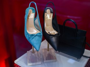 omen's high heel shoes and a handbag in a Christian Louboutin SAS luxury goods store in Paris.