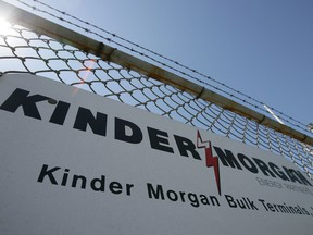 A sign hangs from a fence at a Kinder Morgan facility in Los Angeles, California.