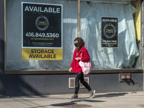 A 'for lease' sign on a closed business in Toronto. Business owners are chafing at the interminable restrictions and the slow pace of Canada's vaccine program. In