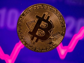 A bitcoin coin against a purple stock chart