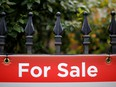 A for sale sign on a fence in Ottawa