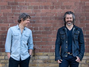 Boat Rocker Media Inc. founders David Fortier, left, and Ivan Schneeberg, right, against a brick wall at their Toronto offices.