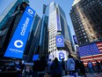 Monitors display Coinbase signage during the company's initial public offering (IPO) at the Nasdaq MarketSite in New York, Wednesday.