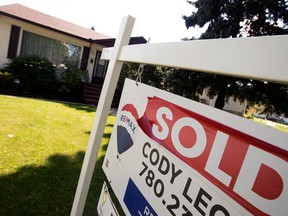 """A real estate sign reading """"sold"""" outside a home in Edmonton"""