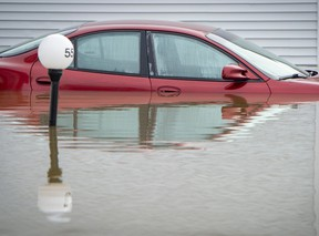An automobile is submerged in flood waters in Sainte-Marthe-sur-le-Lac, a suburb of Montreal, Quebec, Canada,
