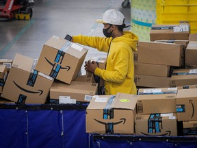 An employee scans packages at Amazon's JFK8 distribution centre in Staten Island, New York.