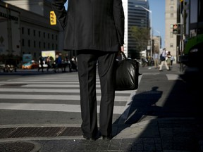 A commuter in Toronto's financial district
