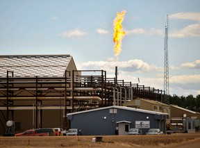 The suspension of steam generation forces this East Primrose steam plant to flare natural gas at Canadian Natural Resources Limited's (CNRL) Primrose Lake oil sands project near Cold Lake, Alberta.