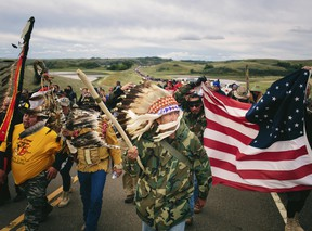 An Iraq War veteran, leads a protest march to a sacred burial ground at the Standing Rock Indian Reservation in North Dakota, Sept. 9, 2016.