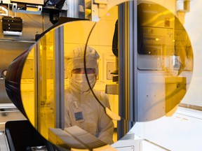 An employee of the semiconductor manufacturer Bosch works in Dresden, eastern Germany.