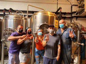 Staff from People's Pint Brewing Company in Toronto in a social media post showing they are fully vaccinated. The brewery was one of the first businesses listed on Safetodo.ca.