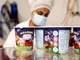 Tubs of ice-cream are seen as a labourer works at Ben & Jerry's factory in Be'er Tuvia, Israel, July 20, 2021.