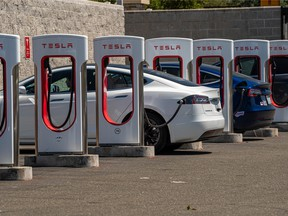 Tesla vehicles at charging stations outside a store in Rocklin, California.