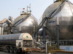 Carbon dioxide storage tanks are seen at a cement plant and carbon capture facility in Wuhu, Anhui province, China.