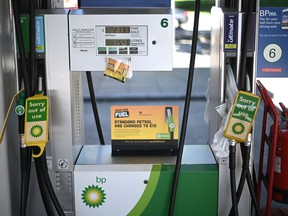 Out of use signs are attached to pumps at a BP petrol station in west London on September 24, 2021.