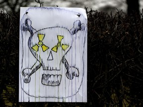 A placard  showing a skull has been left by anti-nuclear protestors near the Reichstag building and the Chancellory in Berlin.