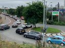 An aerial view shows customers queueing in their cars to access an Asda petrol station in east London on September 25, 2021.