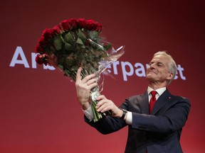 Labor leader Jonas Gahr Store holds a bouquet of red roses after the results of the Labor Party's election event in Folkets Hus, in Oslo, during the 2021 Norwegian parliamentary elections.