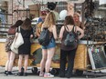 Shoppers peruse a jewellery kiosk on Toronto's Queen Street in August.