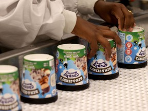 A labourer works on a production line filling ice-cream pots at the Ben & Jerry's factory in Be'er Tuvia in southern Israel.