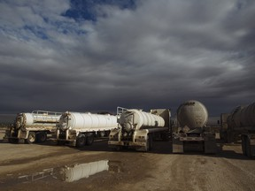 Oil tanker trucks waiting to be filled in Texas. A world racing towards decarbonization due to well-intentioned but not fully informed government policy is propelling us towards an energy crisis.