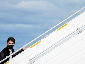 Liberal Prime Minister Justin Trudeau boards his campaign plane in Halifax, on Wednesday.