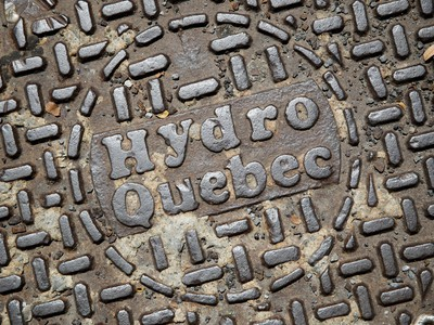 Hydro-Quebec signage is displayed on a manhole cover in Montreal.