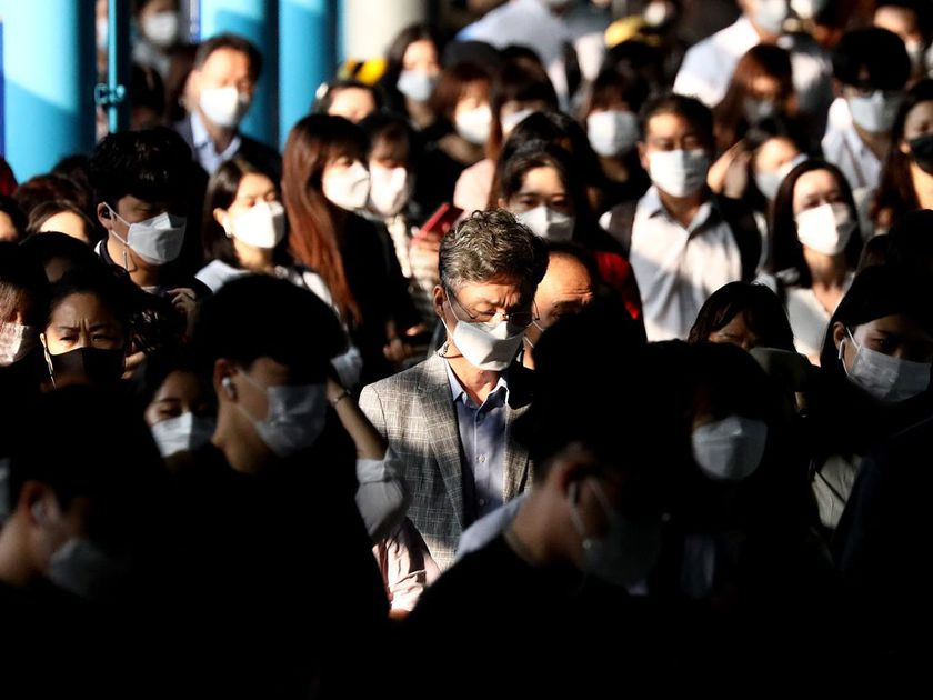 South Korean commuters wear protective masks as they crowd after getting off the subway during rush hour on September 15, 2020 in Seoul, South Korea.