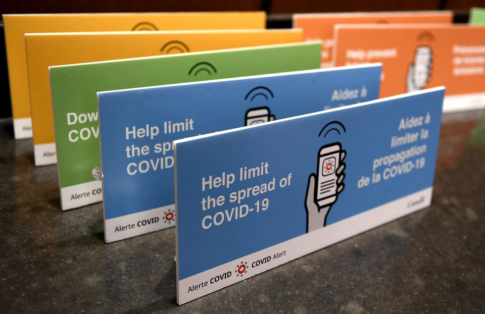 Podium placards promoting the COVID Alert app are seen on a table on Parliament Hill in Ottawa, on Friday, July 31, 2020. The app tracks the locations of phones relative to other phones, and notifies users if they have been in proximity to another app user who has tested positive for COVID-19. THE CANADIAN PRESS/Justin Tang