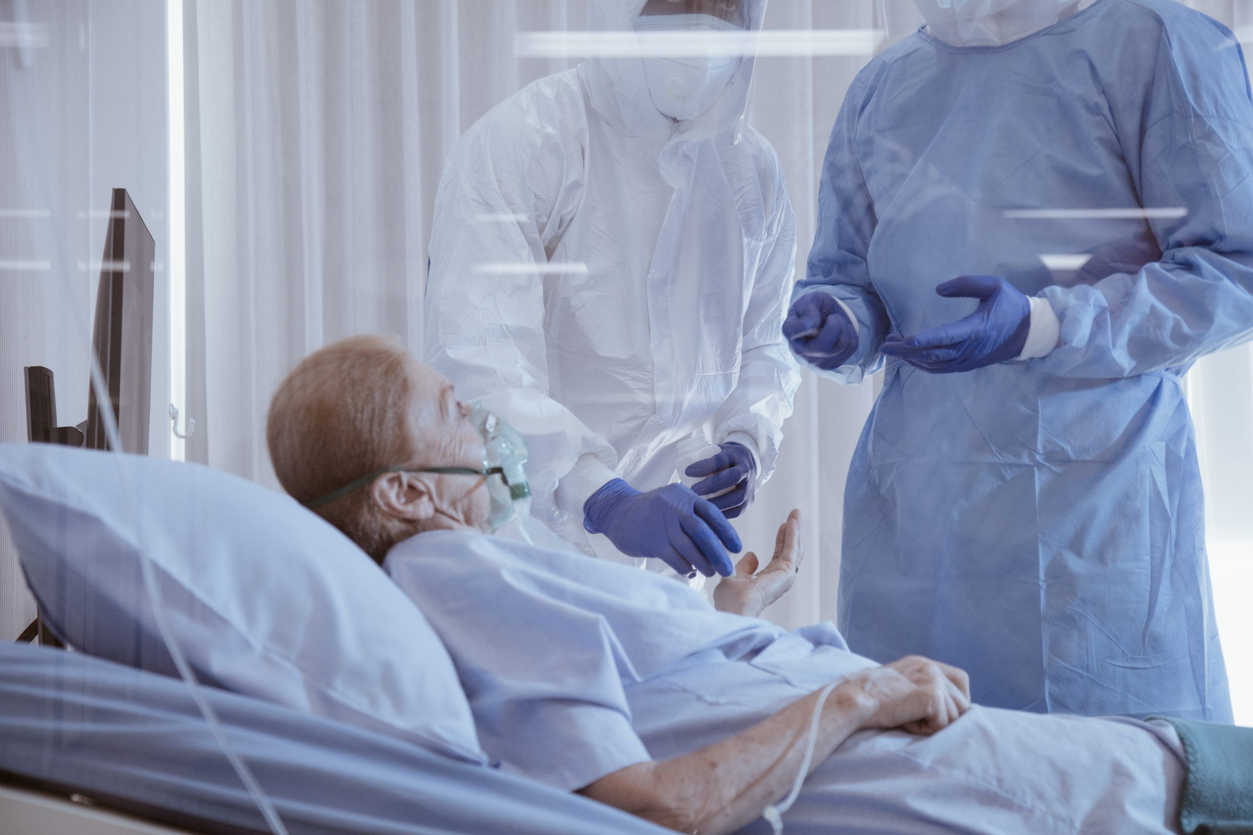 man with oxygen mask on with doctor