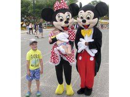 Blake Duggan, 4, and his brother Carter, 10 months, get their photo taken with Disney icons Mickey and Minnie Mouse at Family Fest on the Kenora Harbourfront, Saturday, Aug. 4. Ryan Stelter/Daily Miner and News