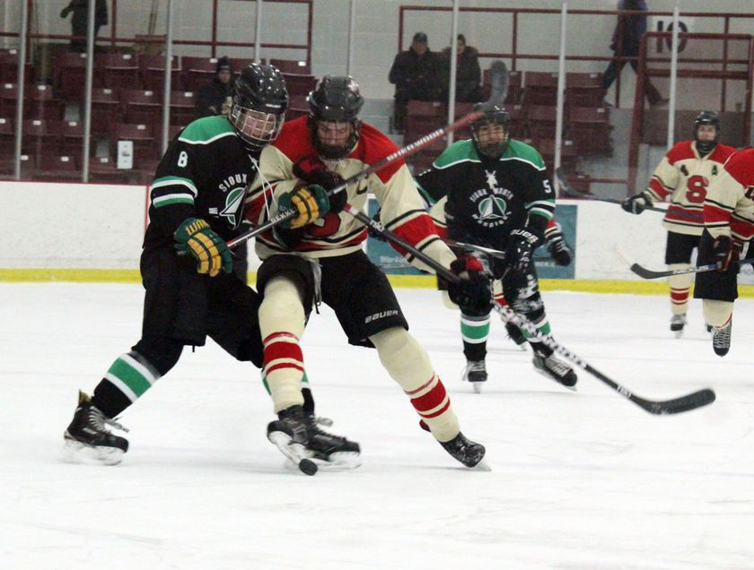 Saints forward Logan Spencer battles with against the Sioux North Warriors on Thursday, Jan. 17 at the Kenora Recreation Centre. Ryan Stelter/Daily Miner and News
