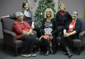 Initial payments were presented before Christmas to representatives of the four shelters supported by the Leader-Post Christmas Cheer Fund. Left to right: Margaret Crowe of WISH Safe House, Amy Stensrud of the YWCA Regina's Isabel Johnson Shelter, Irene Seiberling of the Leader-Post Christmas Cheer Fund, Sarah Valli of SOFIA House and Maria Hendrika of Regina Transition House. PBRYAN SCHLOSSER/Leader-Post.