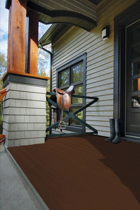 The richness of a wooden deck is an ideal backdrop for a stylish outdoor space. A dark brown stain, such as Mountain Shelter (1713-503) by SICO® paint, pictured on the base of this deck, coordinates well with light grey siding. SICO photo