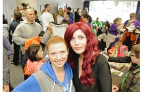 Avery Meyerhoffer, left, and April Predinchuk, right, organizers of Get Active 4 Autism fundraising walk, pose at the Autism Resource Centre in Regina, Sask. on Saturday Aug. 22, 2015.