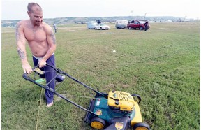 Kelly Bakken of Estevan cuts the weeds in his father's campsite at the Craven Jamboree as the gates opened to campers Tuesday morning July 7, 2015.