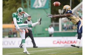 Saskatchewan Roughriders kicker Ray Early (#39) gets illegally contacted by Winnipeg Blue Bombers wide receiver Mike Willie (#99) during the Labour Day Classic held at Mosaic Stadium in Regina, Sask. on Sunday Sep. 6, 2015.