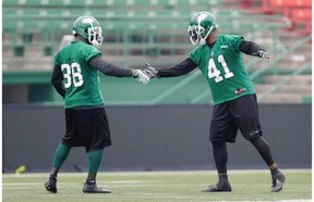 Tristan Jackson (38) welcomes Tyron Brackenridge back to practice (MICHAEL BELL/Leader-Post)
