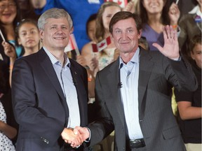 Conservative Leader Stephen Harper shakes hands with Wayne Gretzky during a campaign event in Toronto on Friday, Sept. 18, 2015.