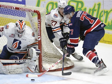 Pats Adam Brooks 77 is tied up by Blazers Nolan Kneen 27as he tries a wrap around on Blazers goal tender Connor Ingram 39 during WHL action between the Regina Pats and the Kamloops Blazers at the Brandt Centre.