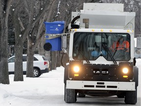 A recycling truck picks up waste in Regina.