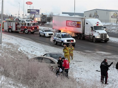 Police, Fire, and EMS respond to the scene of a three car collision on Ring road near Ross Ave. Wednesday morning.