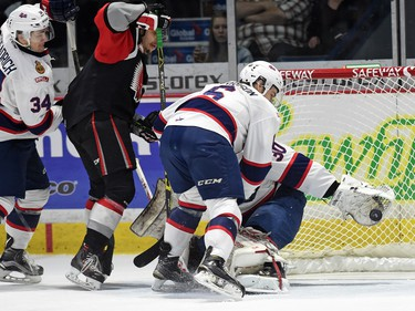 Chase Harrison and net-minder Jordan Hollett with the Regina Pats can't stop the Moose Jaw Warriors from scoring during WHL hockey action at the Brandt Centre in Regina on March 11, 2016.