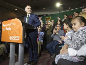 SASKATOON,SK--FEBRUARY 17/2016   0318 news cam broten---  NDP leader Cam Broten speaks during a news conference at TCU Place as five-year-old twins Connor and Devon Hicks, far right, listen, Thursday, March 17, 2016.   (GREG PENDER/ SASKATOON STARPHOENIX)