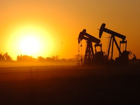 Pumpjacks toil south of Weyburn, where the oilpatch has been hit with layoffs.
