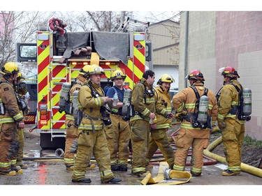 Firefighters at Wilf's Autobody Tuesday afternoon.