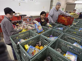 Volunteers work at the Regina Food Bank in Regina ahead its annual 12 Days of Christmas Campaign.